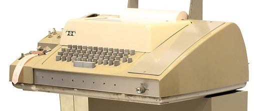 Model 33 teletype with paper tape reader/writer